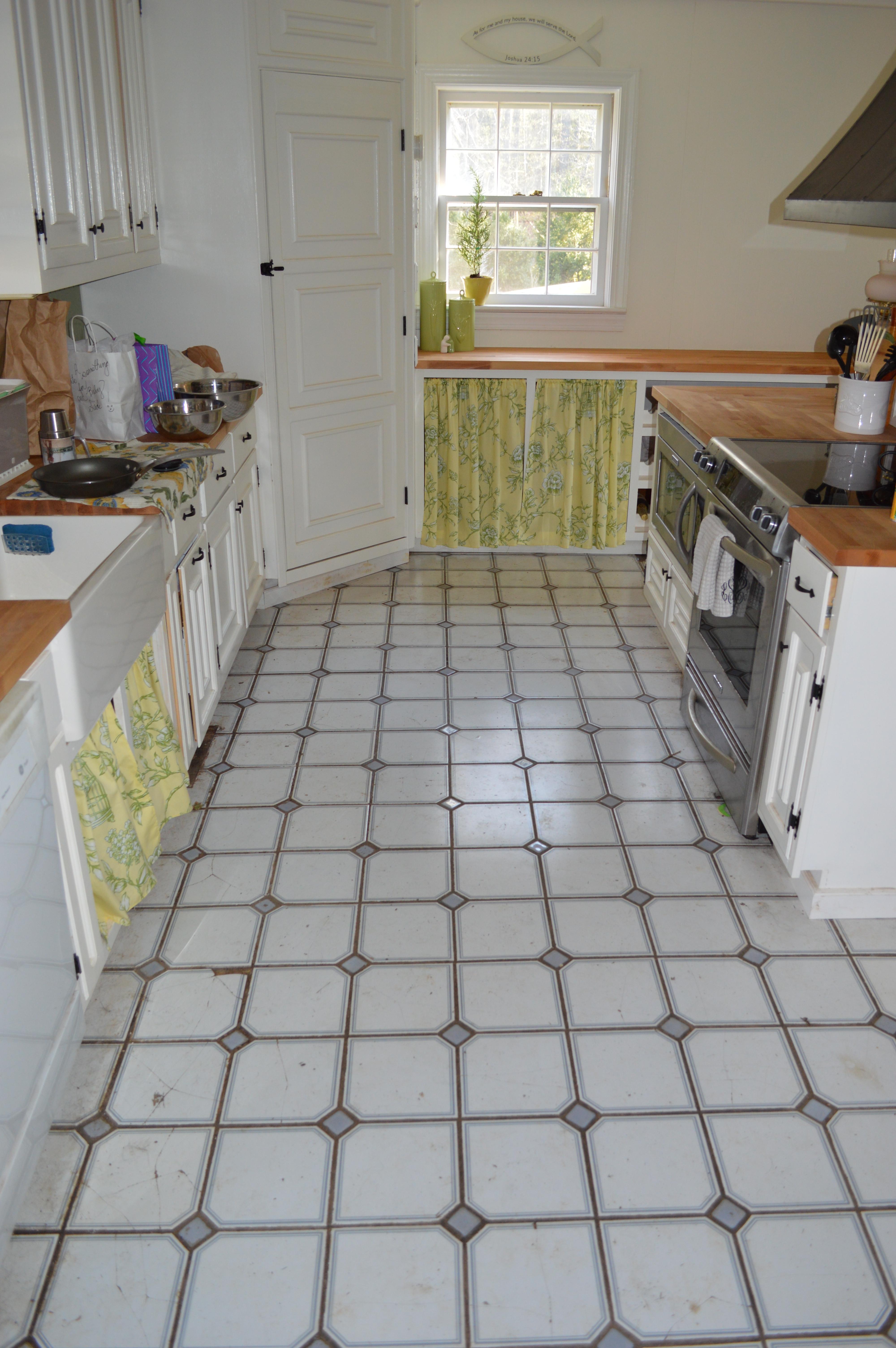 tearing up the kitchen floor | a farmhouse reborn